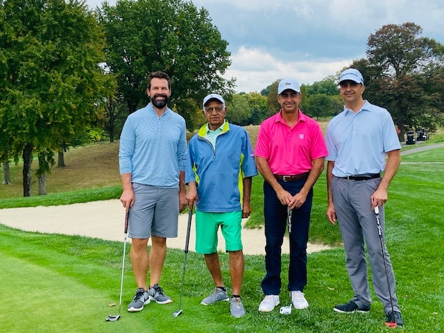 The second place foursome of Hal Chaudhary MD Riaz Chaudhary MD Salem Chaudhary and Andy Law.